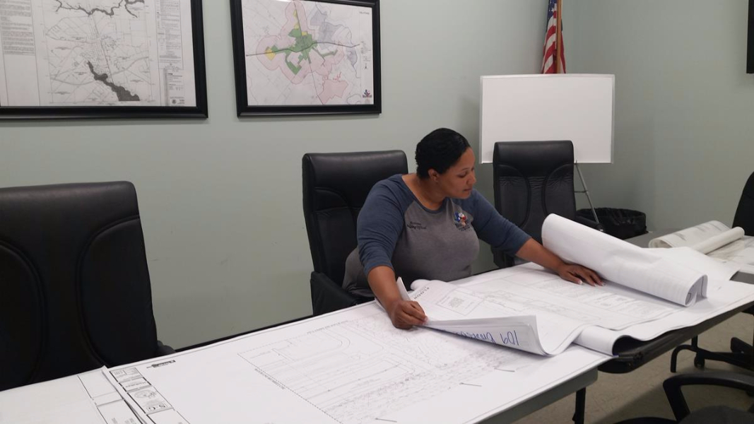 Assistant Building Official, Chrissy McGee, is hard at work reviewing plans to keep up with City growth.