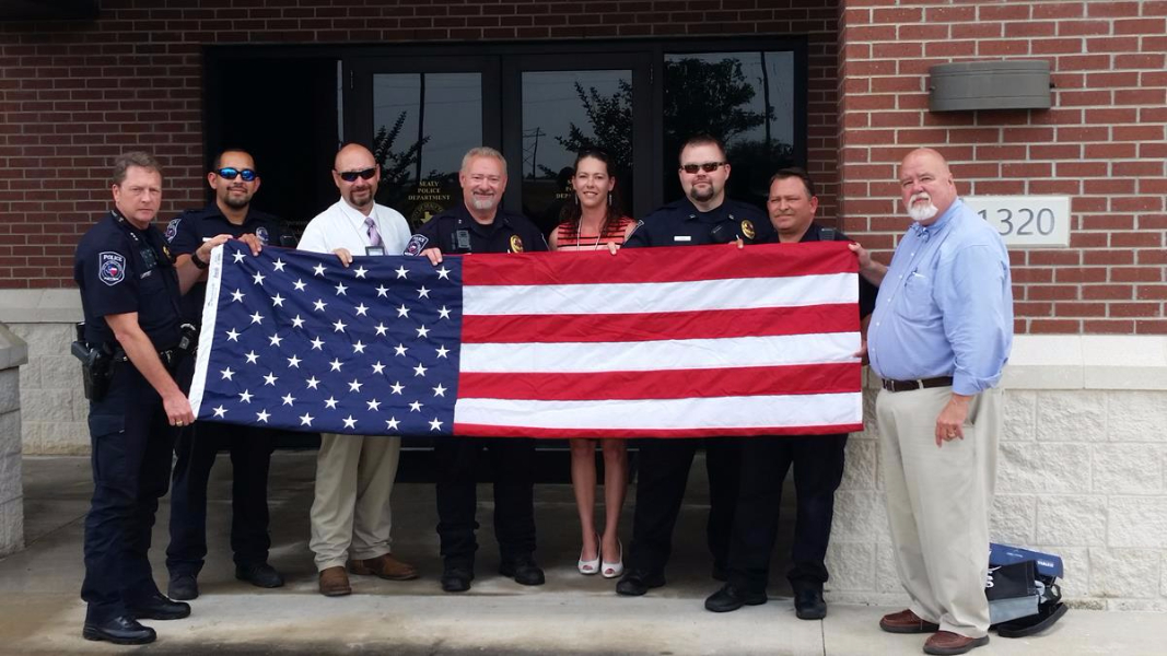 Sealy Police Department is presented with a United States flag from Woodmen of the World. Thank you!